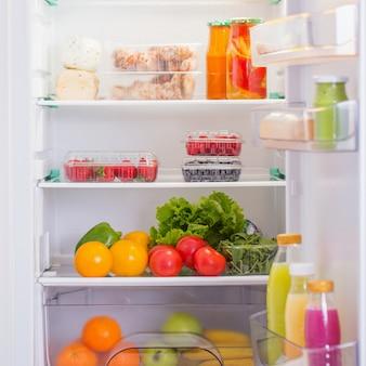 Белый холодильник с разной едой