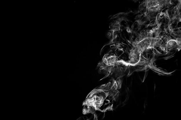 White fume on black background