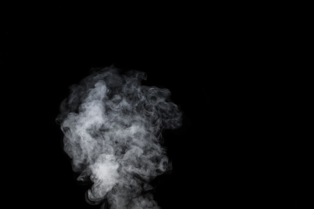 A white fumes, smoke on a black background to add to your pictures. perfect smoke, steam, fragrance, incense for your photos.