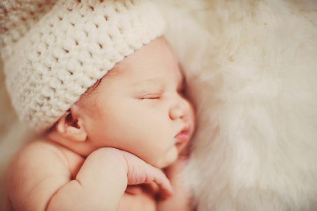 White fur envelopes dreamy little child