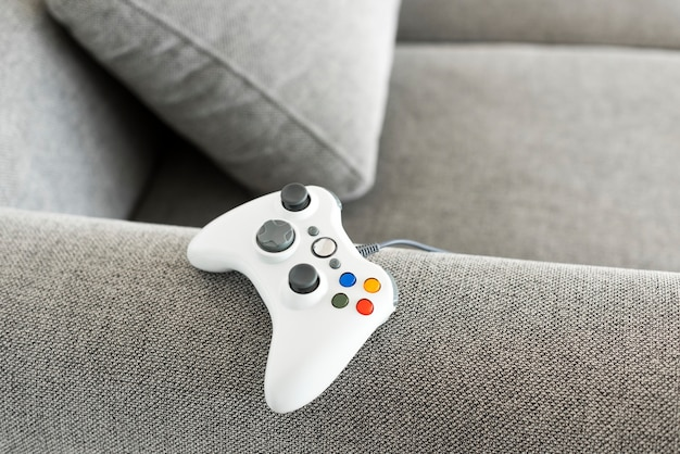 White gaming controller on a sofa