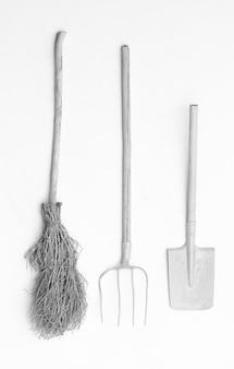 White garden tools isolated on white background