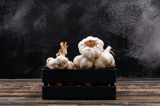 White garlic in the black wood box