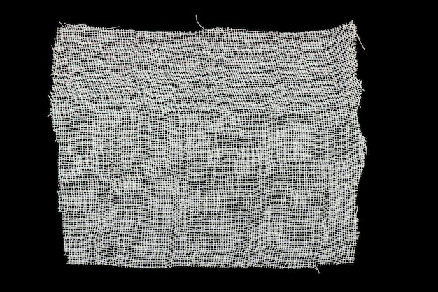 White gauze isolated on black background as texture
