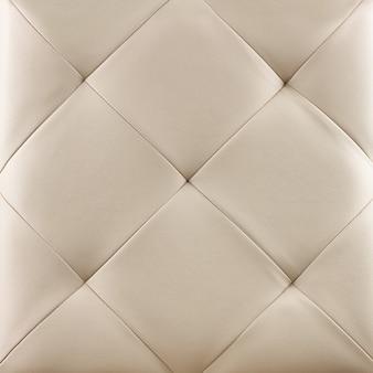 白い本革張りの背景。贅沢なパターン。