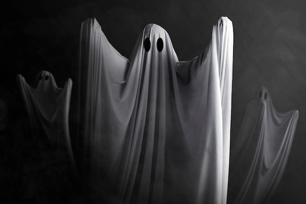 White ghost haunting with a dark wall. halloween concept