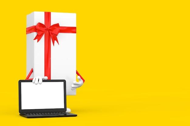 노란색 배경에 디자인을 위한 현대 노트북 컴퓨터 노트북과 빈 화면이 있는 흰색 선물 상자와 빨간 리본 캐릭터 마스코트. 3d 렌더링