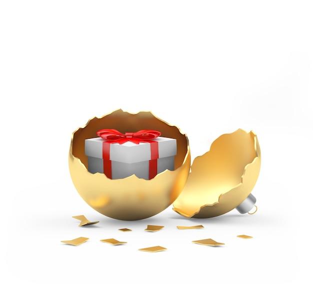 Белая подарочная коробка внутри золотого сломанного елочного шара