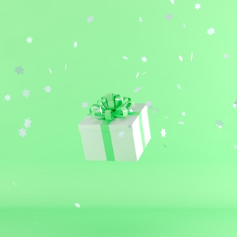 White gift box with green color ribbon on green color background