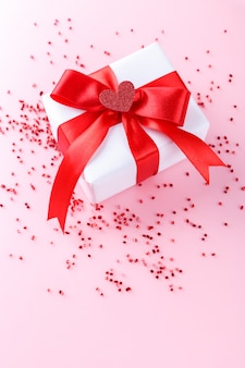 White gift box with hearts
