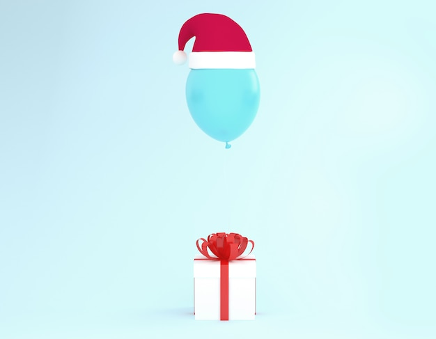 White gift box with red ribbon and balloon with santa hat on blue background.