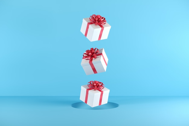 White gift box with red ribbon color floating on blue background