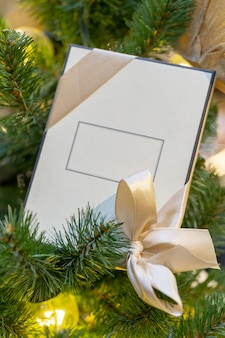 White gift box with space for an inscription, christmas tree decoration