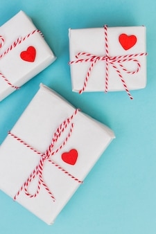 White gift boxes with hearts on table