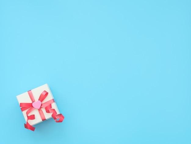 Белая подарочная коробка с красной лентой и розовым сердцем на синем фоне.