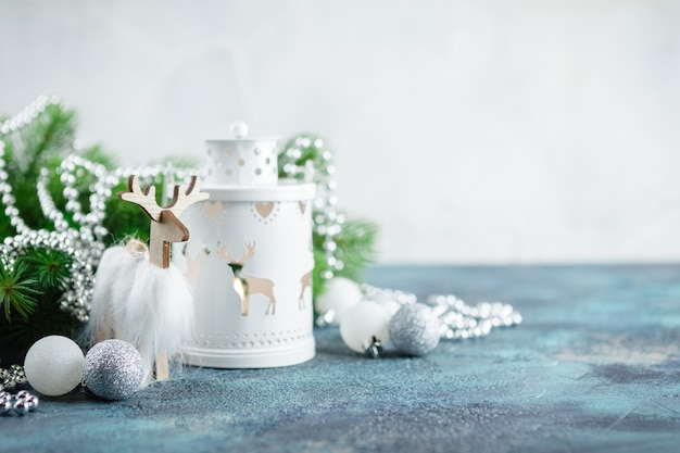 White glass balls and toys, wooden decoration, floor lamp light, wooden deer and pocket whatches