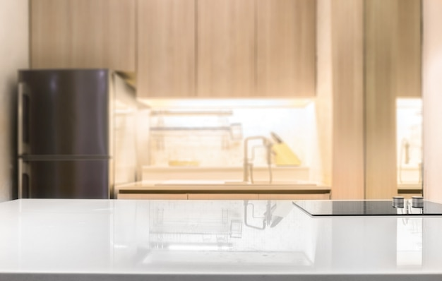 White glossy countertop and  on blur kitchen room background