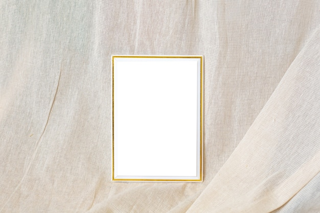 White and gold empty frame with fabric