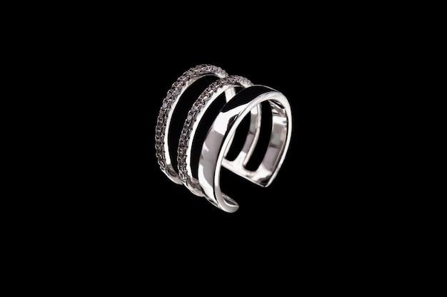 White gold ring on black background