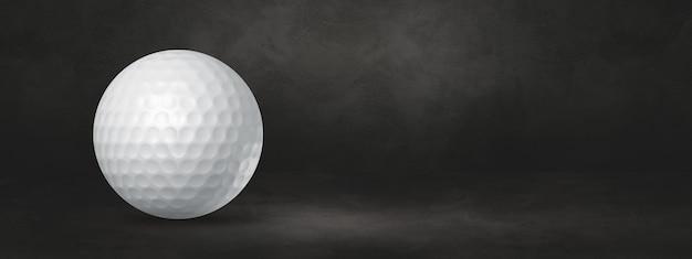 White golf ball isolated on a black studio banner. 3d illustration