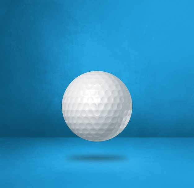 White golf ball isolated on a blue studio background. 3d illustration