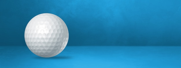White golf ball isolated on a blue