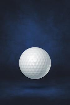 White golf ball isolated on a dark blue studio background. 3d illustration