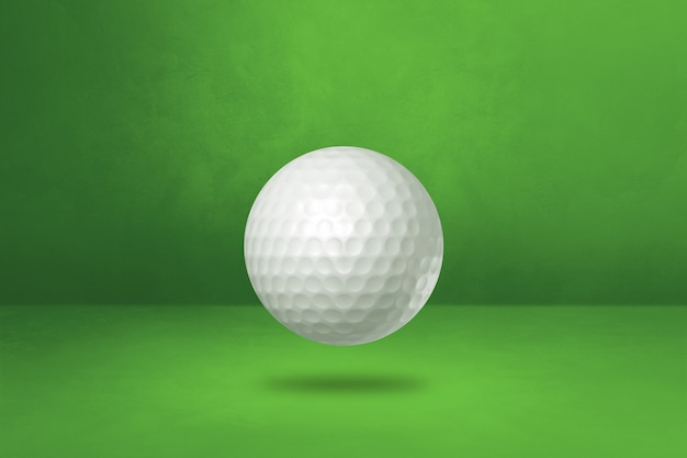 White golf ball isolated on a green studio background. 3d illustration