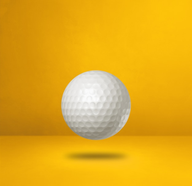 White golf ball isolated on a yellow studio background. 3d illustration