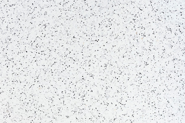 White granite textured tile with black stains