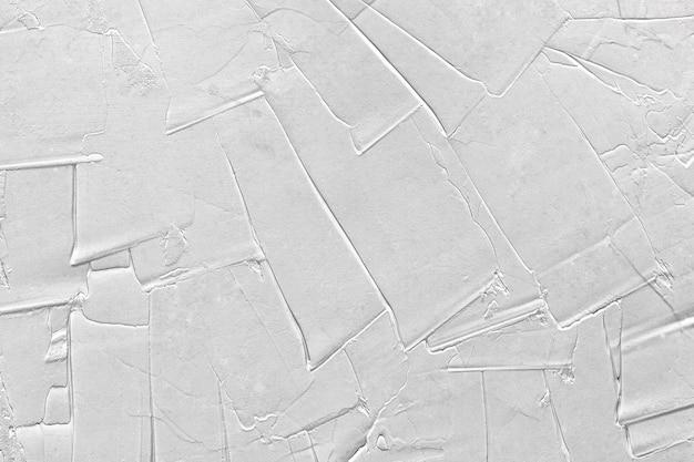 Белая серая текстура силиконовой штукатурки с глубокими царапинами