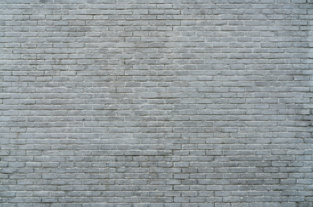 White and grey brick wall texture background with space for text.