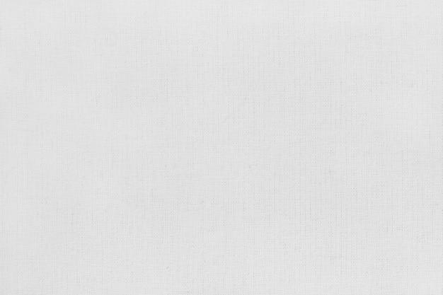 シームレスパターンを持つ白灰色の綿生地のテクスチャです。