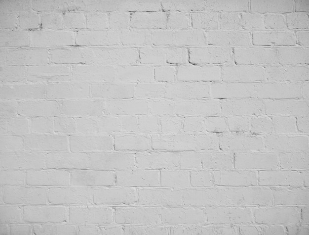 섬세 한 비네팅으로 오래 된 벽돌 벽 텍스처의 흰색 그런 지 배경.