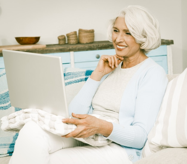 White haired woman with laptop