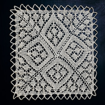 White hand knitted lace on black