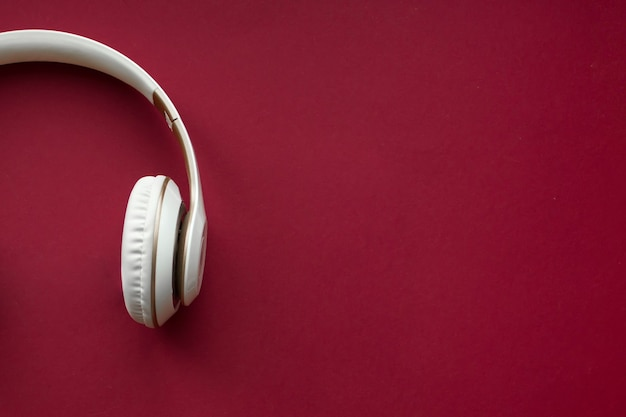 White headphone with red background. headphones for music sound.