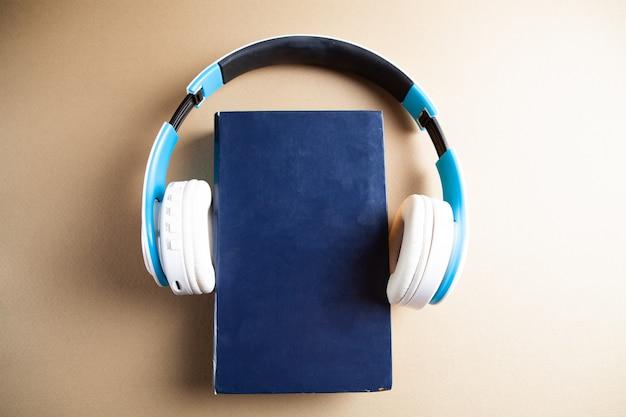 White headphones on the book