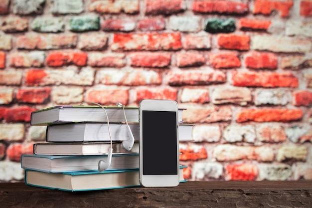 White headphones and books, concept books audiobooks and e-learning,e-book