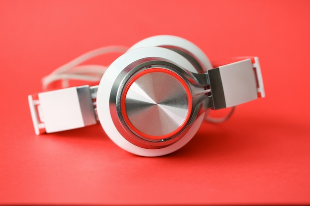 White headphones on coral