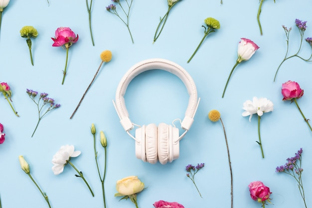 White headphones on a floral, music concept