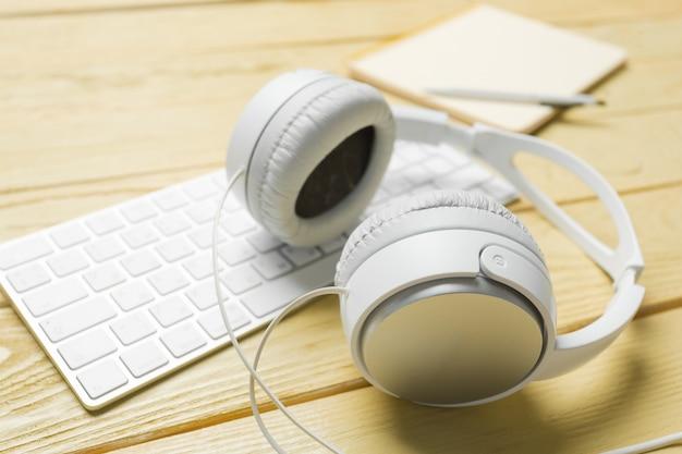 White headphones, keyboard