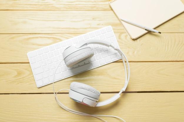 White headphones with keyboard
