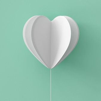 White heart shape on green pastel background.  minimal valentine concept idea.