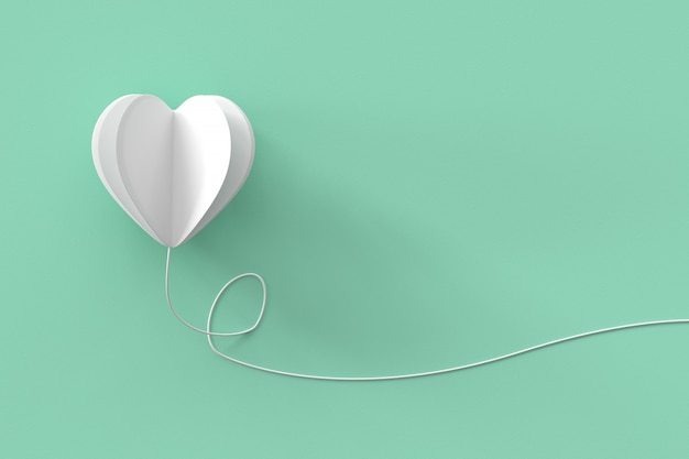 White heart shape with line on green pastel background.  minimal valentine concept idea.