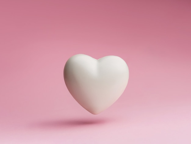 White heart symbol on a pastel pink background.