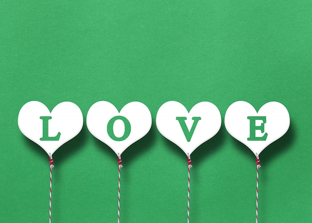 White hearts on a green paper background.