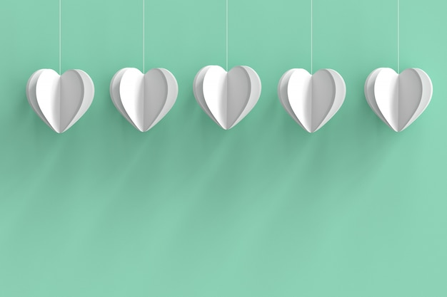 White hearts shape on green pastel background.  minimal valentine concept idea.