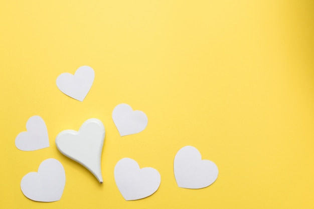 White hearts on yellow background, copy space