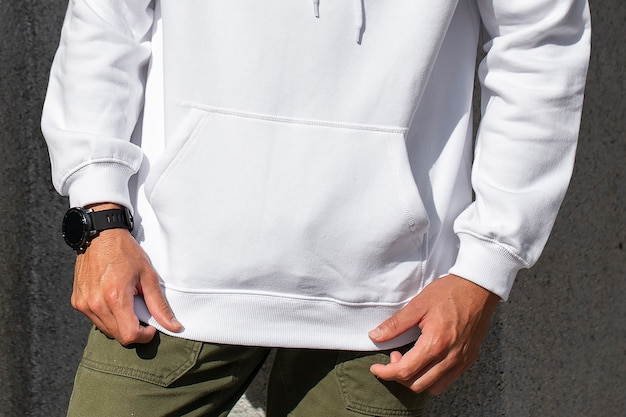 White hoodie on man with green pants closeup photoshoot